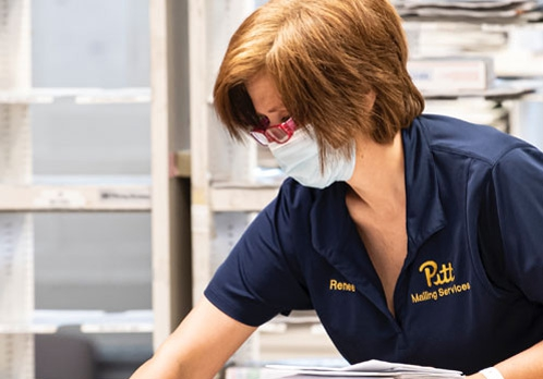 Mailing Services worker wearing a mask
